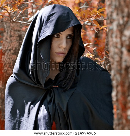 Beautiful woman in fantasy land with red leafs - stock photo