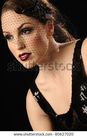 Beautiful woman in fashionable vintage head piece