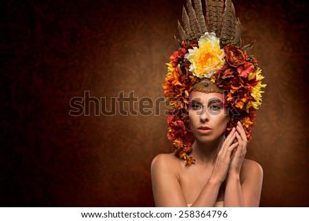 Beautiful woman in flowery autumn headpiece - stock photo