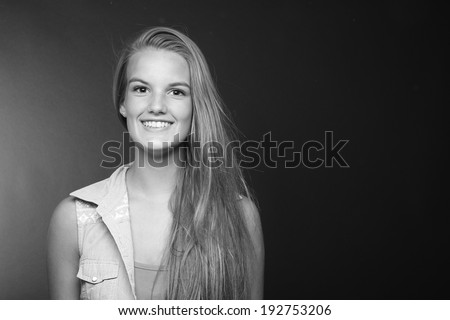 Beautiful woman in front of a white background - stock photo