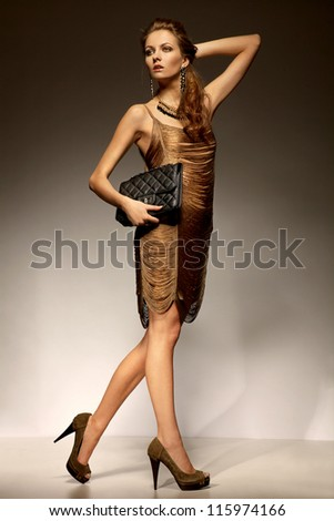 Beautiful woman in glamour evening dress - stock photo
