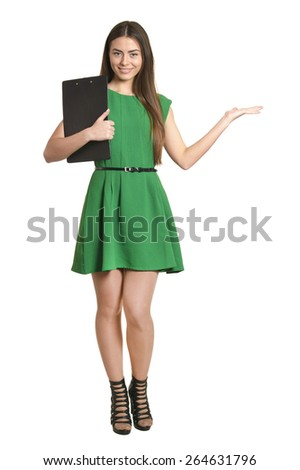 Beautiful woman in green dress with clipboard on white background - stock photo