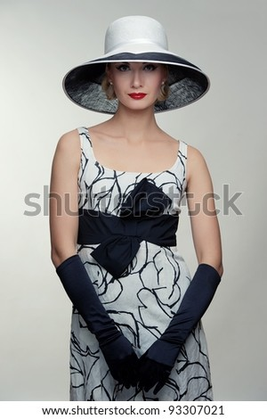 Beautiful woman in hat. - stock photo