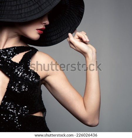 Beautiful woman in hat. Retro fashion. - stock photo