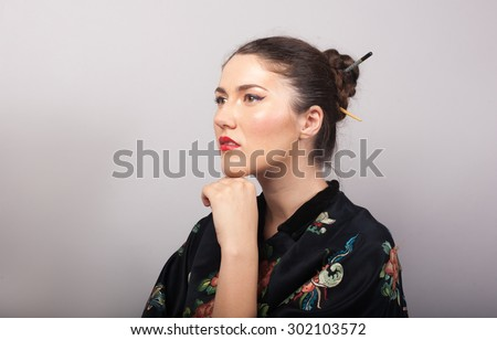 beautiful woman in kimono thinks