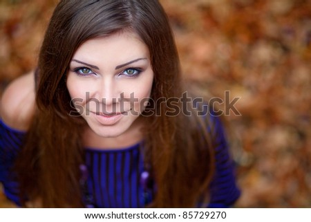 Beautiful woman in leaves - stock photo