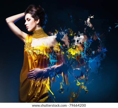 beautiful woman in long dress with jewelry and splatter - stock photo
