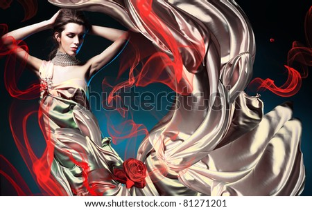 beautiful woman in long fairy dress and red abstract - stock photo