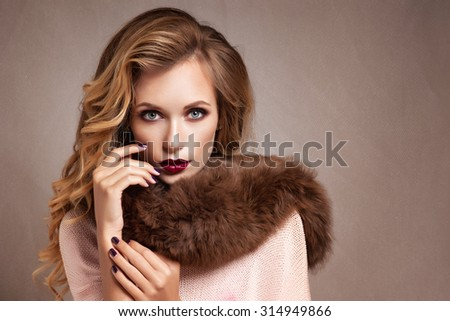 Beautiful Woman in Luxury Fur Coat - stock photo