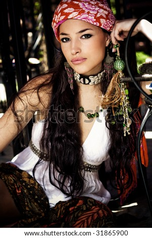 beautiful woman in oriental clothes, outdoor shot - stock photo