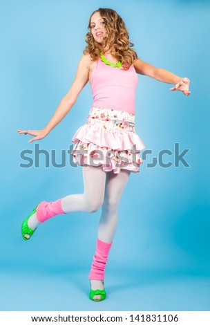 Beautiful woman in pink clothers dancing at studio - stock photo