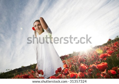 Beautiful woman in poppy - stock photo