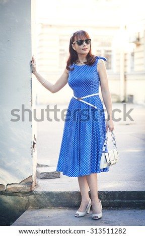 Beautiful woman in retro style dress outdoor