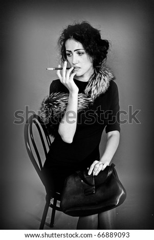 beautiful woman in retro style with a cigarette, black and white