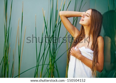 Beautiful woman in salon - stock photo