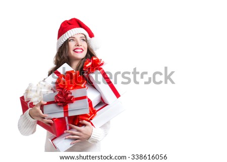 Beautiful woman in santa hat and gifts. Christmas and New Year 2016. - stock photo
