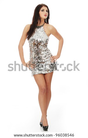Beautiful woman in shiny sexy dress, isolated on white background - stock photo