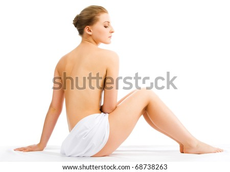 Beautiful woman in spa center on white background