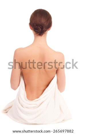 beautiful woman in spa sitting with a back