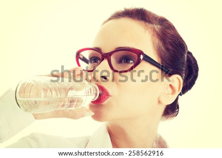 Beautiful woman in suit drinking water. - stock photo