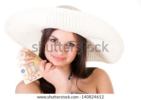 beautiful woman in summer dress with hat and money over white background - stock photo
