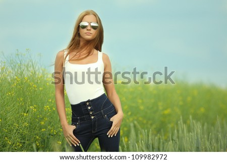 Beautiful woman in sunglasses - stock photo