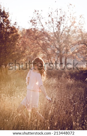 Beautiful woman  in the autumn forest - stock photo