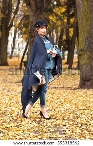 Beautiful woman in  the  city, autumn in park - stock photo