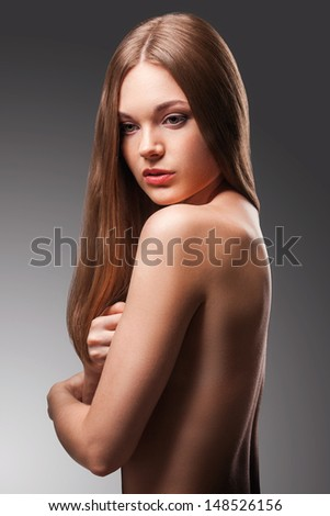 beautiful woman in the fog with naked back portrait over gradient background - stock photo