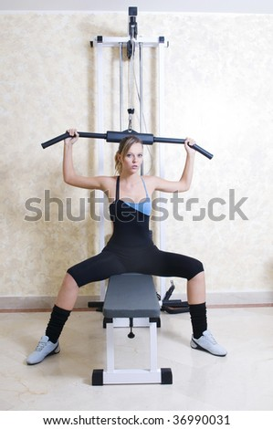 beautiful woman in the gym with weight - stock photo