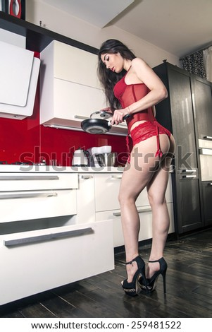 beautiful woman in the kitchen in red lingerie