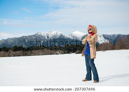 Beautiful woman in the snowy mountain - stock photo