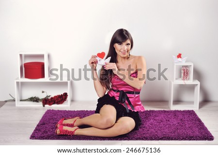 beautiful woman in the studio holding a heart on Valentine's Day.