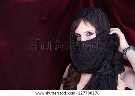 Beautiful woman in traditional veil - stock photo