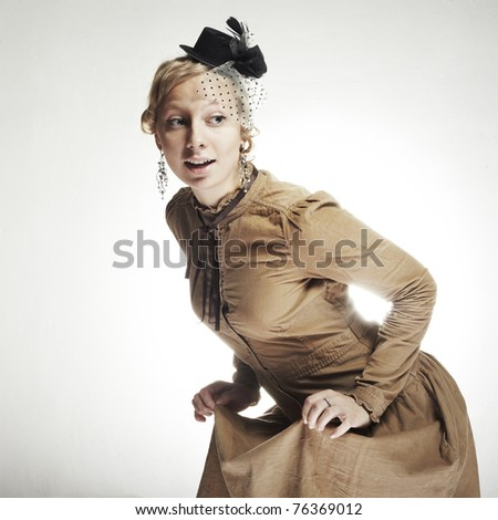 Beautiful woman in vintage dress - stock photo