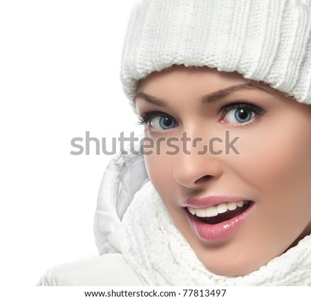 beautiful woman in warm clothing on white background smiling - stock photo
