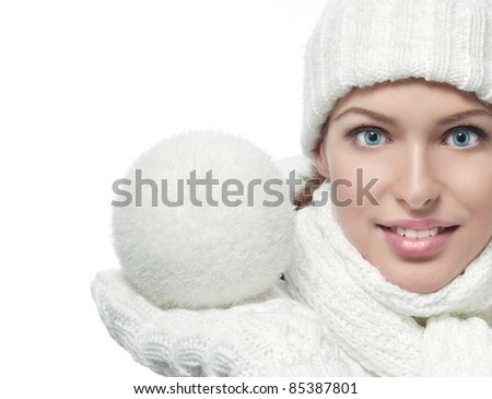 beautiful woman in warm clothing with snowball closeup portrait - stock photo