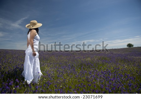 beautiful woman in white dress relaxing in the nature - stock photo