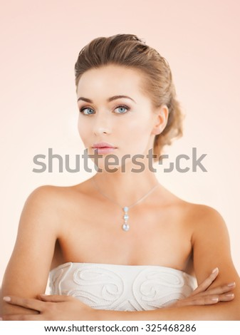 beautiful woman in white dress with diamond necklace - stock photo