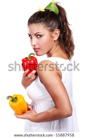 beautiful woman in white dress with fresh paprika