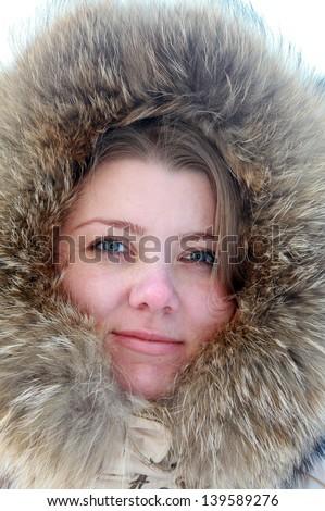 Beautiful woman in winter furry hood - stock photo