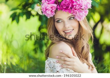 beautiful woman in wreath of flowers - stock photo