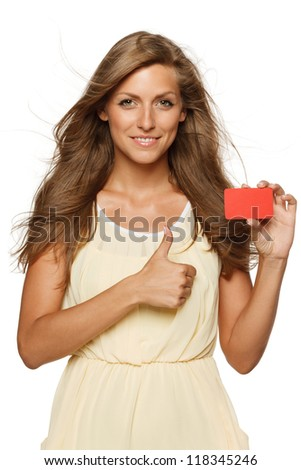 Beautiful woman in yellow dress holding empty credit card and showing thumb up sign,  isolated on white background - stock photo