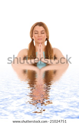 Beautiful woman in yoga pose with water reflection. - stock photo