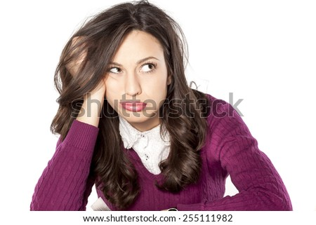 beautiful woman is bored and thinking - stock photo
