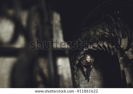 beautiful woman is doing a photo shoot in an interesting place