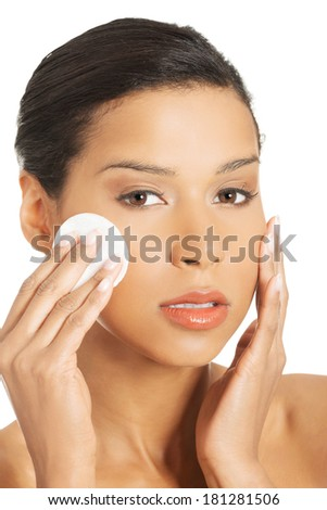 Beautiful woman is holding a cosmetic pad.