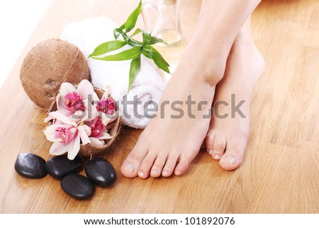 Beautiful woman legs and different spa items