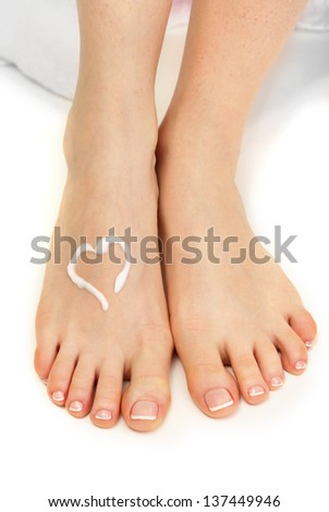 Beautiful woman legs with cream, isolated on white - stock photo