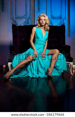 Beautiful woman like a princess in the palace. Luxurious rich fashion stylish girl in a long evening dress. - stock photo